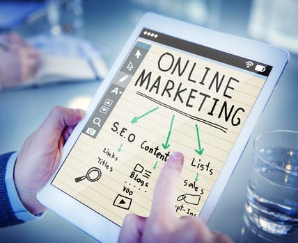 hands hold an iPad with an online marketing plan for SEO Edinburgh written on a notepad on the screen