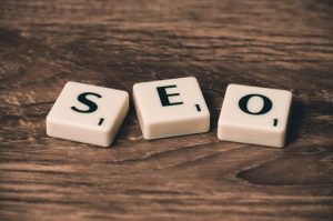 SEO spelled out with scrabble tiles on wooden table at SEO Edinburgh office